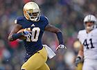 Nov. 23, 2013; Wide receiver DaVaris Daniels (10) runs for a touchdown against BYU.<br /> <br /> Photo by Matt Cashore