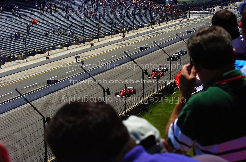Rubens Barrichello (#2-Ferrari) and teammate Michael Schumacher (#1-Ferrari) lead the field to the first turn.