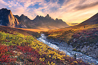 Beautiful sunset light and colorful tundra looking toward Tombstone Mountain during Autumn in the Ogilvie Mountain wilderness, Yukon Territory.<br />