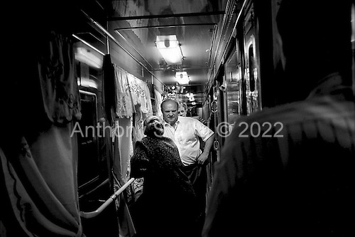 Novgorod, Russia.1996.Russian Communist Party leader Gennadi Zyuganov aboard a train bound for Kirov, at 2AM with hs staff, as they make their way westardon the campaign for the Russian President.