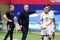 Steve Cooper Head Coach of Swansea City shouts instructions to his team from the dug-out during the Sky Bet Championship match between Swansea City and Sheffield Wednesday at the Liberty Stadium in Swansea, Wales, UK. Sunday 05 July 2020