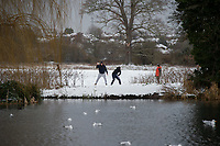 Friends have a snowball fight following snowfall at Foots Cray Meadow, Sidcup, Kent, England on the 9 February 2021. Photo by Alan Stanford.