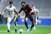 CARY, NC - DECEMBER 13: Ousseni Bouda #11 of Stanford University is challenged by Dylan Nealis #12 of Georgetown University during a game between Stanford and Georgetown at Sahlen's Stadium at WakeMed Soccer Park on December 13, 2019 in Cary, North Carolina.