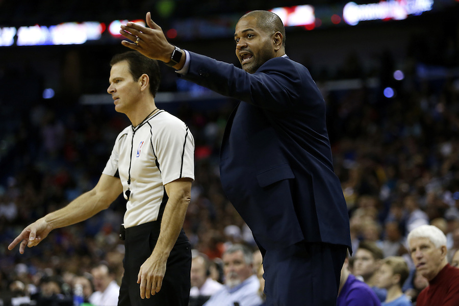 Houston Rockets interim head coach J.B. Bickerstaff reacts during the second half of an NBA basketball game against the New Orleans Pelicans Saturday, Dec. 26, 2015, in New Orleans. The Pelicans won 110-108. (AP Photo/Jonathan Bachman)