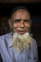 Bangladesh, Cox's Bazar. Kutupalong Rohingya Refugee Camp. The Rohingya, a Muslim ethnic group  denied citizenship in Burma/Myanmar have escaped persecution from Burmese militants in their country. There are up to 500,000 migrants and refugees living in makeshift camps in Cox's Bazar. Old man.