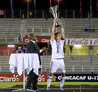 Andrew Souders (2) of the United States holds up the trophy after the finals of the CONCACAF Men's Under 17 Championship at Catherine Hall Stadium in Montego Bay, Jamaica. The United States defeated Canada, 3-0, in overtime