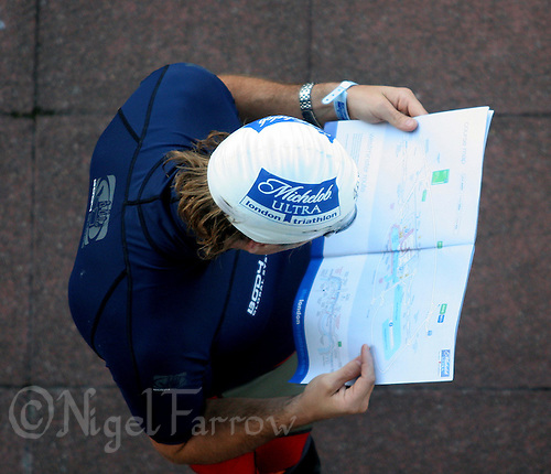 07 AUG 2005 - LONDON, GBR - A competitor studies the course map before the start of his wave at the London Triathlon .(PHOTO (C) NIGEL FARROW)