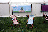 Friday 23 May 2014, Hay on Wye UK<br /> Pictured: Empty reclining chairs due to the heavy rain.<br /> Re: The Telegraph Hay Festival, Hay on Wye, Powys, Wales UK.