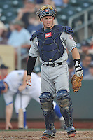 The Reno Aces catcher Ryan Budde #6 looks to bench for a signal during the game against the Omah Storm Chasers at Werner Park on August 3, 2012 in Omaha, Nebraska.(Dennis Hubbard/Four Seam Images)
