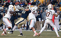 Pitt defensive tackle Aaron Donald (97) gets blocked by Miami linemen Danny Isidora (63) and Brandon Linder (65) as Miami quarterback Stephen Morris (17) get ready to pass. The Miami Hurricanes defeated the Pitt Panthers 41-31 at Heinz Field, Pittsburgh, Pennsylvania on November 29, 2013.