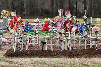 a heavily decorated grave site, Virginia, USA
