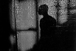 Shadow of a fighter on the north wall at Gleason's Gym, Brooklyn, New York.<br />Photograph by Thierry Gourjon-Bieltvedt. 1995-2005