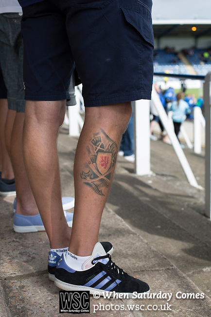 Queen of the South 2 Stranraer 0, 11/08/2015. Scottish Challenge Cup first round, Palmerston Park. A home supporter with a Scottish tattoo pictured in the Portland Drive terrace end during the second-half at Palmerston Park, Dumfries, as Queen of the South (in blue) host Stranraer in a Scottish Challenge Cup first round match. The game was the opening match of the season in a competition open to sides below the Scottish Premiership. Queen of the South won the match 2-0, watched by a crowd of 1229 spectators. Photo by Colin McPherson.