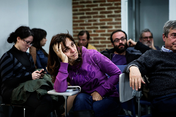 Madrid, Spain, February 12, 2015. A member of the left wing [party] Podemos gestures during their weekly meeting in Salamanca's neighbourhood in Madrid.