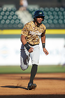 Leody Taveras (3) of the Down East Wood Ducks hustles towards third base against the Winston-Salem Dash at BB&T Ballpark on May 12, 2018 in Winston-Salem, North Carolina. The Wood Ducks defeated the Dash 7-5. (Brian Westerholt/Four Seam Images)
