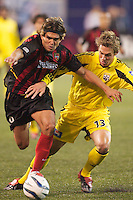 Jaime Moreno of the MetroStars and Brian Dunseth of the Crew battle for the ball. The Columbus Crew defeated the NY/NJ MetroStars 1-0 on 4/12/03 at Giant's Stadium, NJ.
