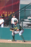 Scott Heineman (9) of the Oregon Ducks in the field at first base during a game against the Southern California Trojans at Dedeaux Field on April 18, 2015 in Los Angeles, California. Oregon defeated Southern California, 15-4. (Larry Goren/Four Seam Images)