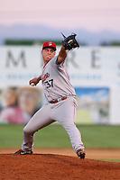Erik Swanson #37 of the Spokane Indians pitches against the Salem-Keizer Volcanoes at Volcanoes Stadium on July 26, 2014 in Keizer, Oregon. Spokane defeated Salem-Keizer, 4-1. (Larry Goren/Four Seam Images)