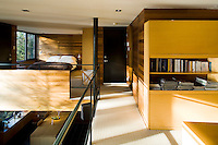 The bedroom on the mezzanine level is situated above the dining area