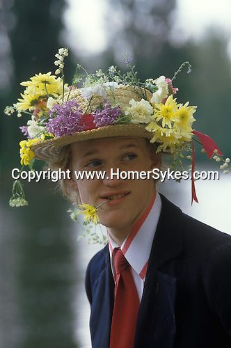 Eton schoolboy in floral hat Founders Day Parents day June 4th celebrations.  The English Season published by Pavilon Books 1987. <br /> <br /> The young man is Philip R Thornton.