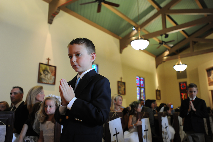 Bernie Smith's Second Grade class from Holy Spirit School celebrated their First Communion at Holy Spirit Catholic Church with Father Daniel Looney, Saturday, May 12, 2012 in Sacramento, California's Land Park neighborhood. (photo by Pico van Houtryve)