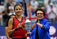 11th September 2021: Billie Jean King Tennis Centre, New York, USA; US Open Tennis, womens singles final. Emma Raducanu (GBR) with her trophy from Billie Jean King as she beats Canada's Leylah Fernandez in 2 sets to win the title.