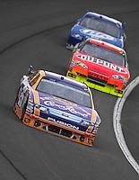 Feb 22, 2009; Fontana, CA, USA; NASCAR Sprint Cup Series driver Jamie McMurray leads Jeff Gordon and Kurt Busch during the Auto Club 500 at Auto Club Speedway. Mandatory Credit: Mark J. Rebilas-
