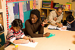 After school academic support program children in early primary grades: first and second grade, assisted by trained adults to finish homework