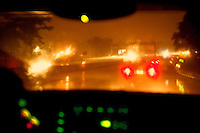 Driving a car  in a rain storm.