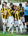 East Fife's Liam Buchanan (19) celebrates with Lewis Barr (8), Kevin Smith(10) and Nathan Austin after he scores their first goal from the penalty spot.
