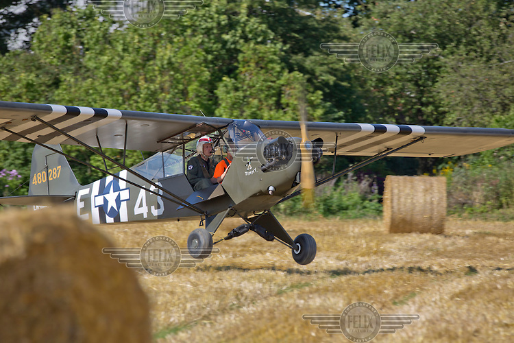 Piper L-4J Grasshopper  coming in to land. <br /> <br /> Airplanes and reenactors photographed at in connection with Høytorptreffet, an annual event at the Høytorp fort. <br /> <br /> Høytorp fort is a barrage fort in the Glomma defence line, built 1912-17. On April 13th and 14th 1940 the fort was in combat against German army units . It is now protected as a national monument.<br /> <br /> ©Fredrik Naumann/Felix Features