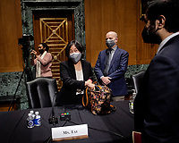 Katherine C. Tai, center, packs up while husband Robert Skidmore waits behind her after the United States Senate Finance committee hearings to examine her nomination to be United States Trade Representative, with the rank of Ambassador, in Washington, DC.<br /> Credit: Bill O'Leary / Pool via CNP /MediaPunch