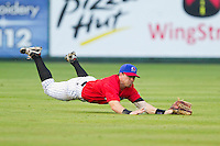 Kannapolis Intimidators left fielder Kale Kiser (9) makes a diving catch during the South Atlantic League game against the Greensboro Grasshoppers at CMC-Northeast Stadium on July 13, 2013 in Kannapolis, North Carolina.  The Intimidators wore throwback jerseys of the Piedmont Boll Weevils, who played in Kannapolis from 1996-2000.   (Brian Westerholt/Four Seam Images)