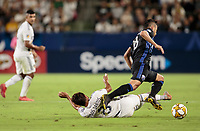 CARSON, CA - SEPTEMBER 21: Jonathan dos Santos #8 of the Los Angeles Galaxy slides tackles Saphir Taïder #8 of the Montreal Impact during a game between Montreal Impact and Los Angeles Galaxy at Dignity Health Sports Park on September 21, 2019 in Carson, California.