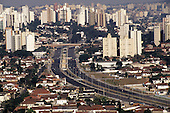 Sao Paulo, Brazil. Overview of high rise office and residential buildings in the city centre with 8 lane dual cariageway road