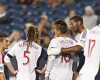 Real Salt Lake defender Chris Schuler (28) confers with Real Salt Lake defender Carlos Salcedo (16) after Carlos Salcedo received a Yellow Card. In a Major League Soccer (MLS) match, Real Salt Lake (white)defeated the New England Revolution (blue), 2-1, at Gillette Stadium on May 8, 2013.