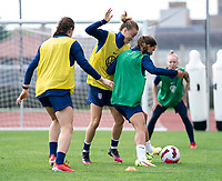 CLEVELAND, OH - SEPTEMBER 14: Emily Sonnett defends Tobin Heath of the United States during a training session at the training fields on September 14, 2021 in Cleveland, Ohio.