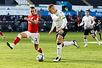(L-R) Jack Hunt of Bristol City challenges Conor Hourihane of Swansea City  during the Sky Bet Championship match between Swansea City and Bristol City at the Liberty Stadium, Swansea, Wales, UK. Saturday 27 February 2021