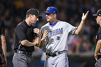 Durham Bulls manager Jared Sandberg (22) argues a call with third base umpire Alex Tosi during the game against the Charlotte Knights at BB&T BallPark on May 15, 2017 in Charlotte, North Carolina. The Knights defeated the Bulls 6-4.  (Brian Westerholt/Four Seam Images)