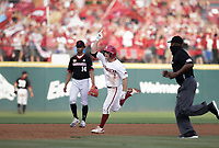 Arkansas infielder Robert Moore (1) runs home for a score, Monday, June 7, 2021 in the fifth inning of the NCAA Fayetteville Regional at Baum-Walker Stadium in Fayetteville. Check out nwaonline.com/210608Daily/ for today's photo gallery. <br /> (NWA Democrat-Gazette/Charlie Kaijo)