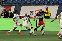 FOXBOROUGH, UNITED STATES - AUGUST 20: Jose Martinez #8 of Philadelphia Union and Jamiro Monteiro #10 of Philadelphia Union move to tackle Kelyn Rowe #11 of New England Revolution as he advances down the field during a game between Philadelphia Union and New England Revolution at Gilette on August 20, 2020 in Foxborough, Massachusetts.