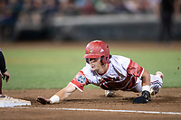 Louisville Cardinals outfielder Drew Campbell (1) dives back to first base during Game 10 of the NCAA College World Series against the Mississippi State Bulldogs on June 20, 2019 at TD Ameritrade Park in Omaha, Nebraska. Louisville defeated Mississippi State 4-3. (Andrew Woolley/Four Seam Images)
