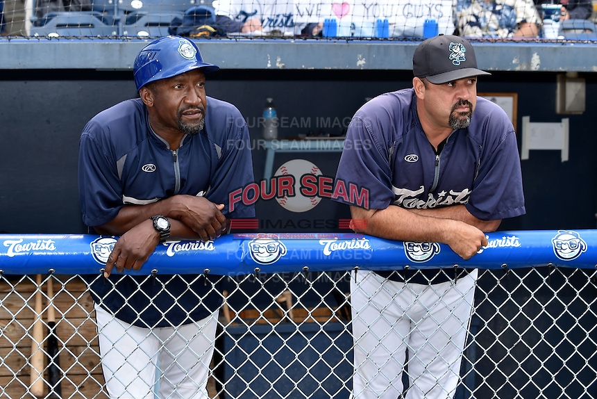 Asheville Tourists hitting coach Mike Devereaux #12 and manager Fred Ocasio #28 before a game against the Asheville Tourists at McCormick Field on September 8, 2014 in Asheville, North Carolina. The Tourists defeated the Suns 16-7. (Tony Farlow/Four Seam Images)