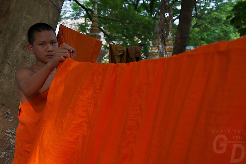 Monk hanging up his robes for drying at a Monastery in Vientiane,Laos