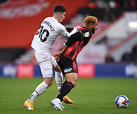 31st October 2020; Vitality Stadium, Bournemouth, Dorset, England; English Football League Championship Football, Bournemouth Athletic versus Derby County; Tom Lawrence of Derby County competes for the ball with Joshua King of Bournemouth