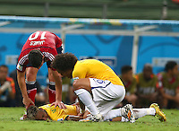 Neymar of Brazil goes down with a back injury before being stretchered off