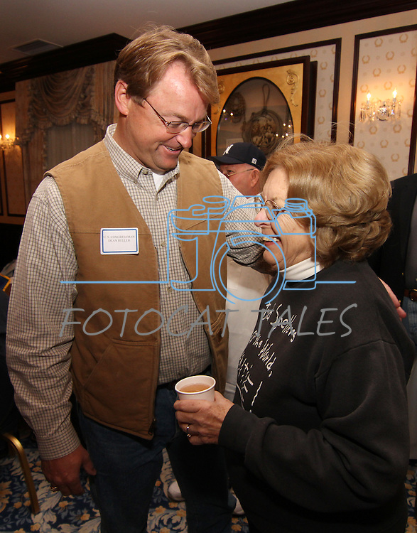 Congressman Dean Heller talks with Joan Reid during the annual Carson City Republican Women's Nevada Day Pancake Breakfast at the Governor's Mansion on Saturday morning, Oct. 30, 2010, in Carson City, Nev. .Photo by Cathleen Allison