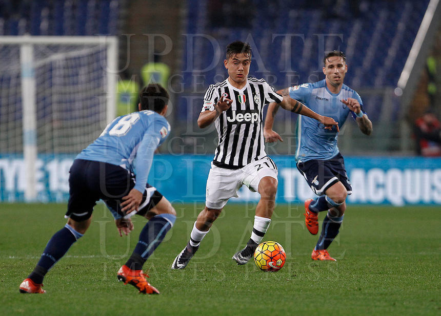 Calcio, Serie A: Lazio vs Juventus. Roma, stadio Olimpico, 4 dicembre 2015.<br /> Juventus' Paulo Dybala, center, is challenged by Lazio's Santiago Gentiletti, left, and Lucas Biglia during the Italian Serie A football match between Lazio and Juventus at Rome's Olympic stadium, 4 December 2015.<br /> UPDATE IMAGES PRESS/Isabella Bonotto