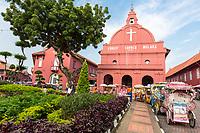 Trishaws Await Tourists in front of Christ Church, Built 1753, Melaka, Malaysia.