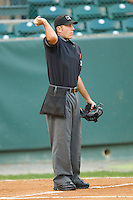 Home plate umpire Pat Hoberg throws out the first baseball prior to the start of the Appalachian League game between the Greeneville Astros and the Pulaski Mariners at Calfee Park August 29, 2010, in Pulaski, Virginia.  Photo by Brian Westerholt / Four Seam Images